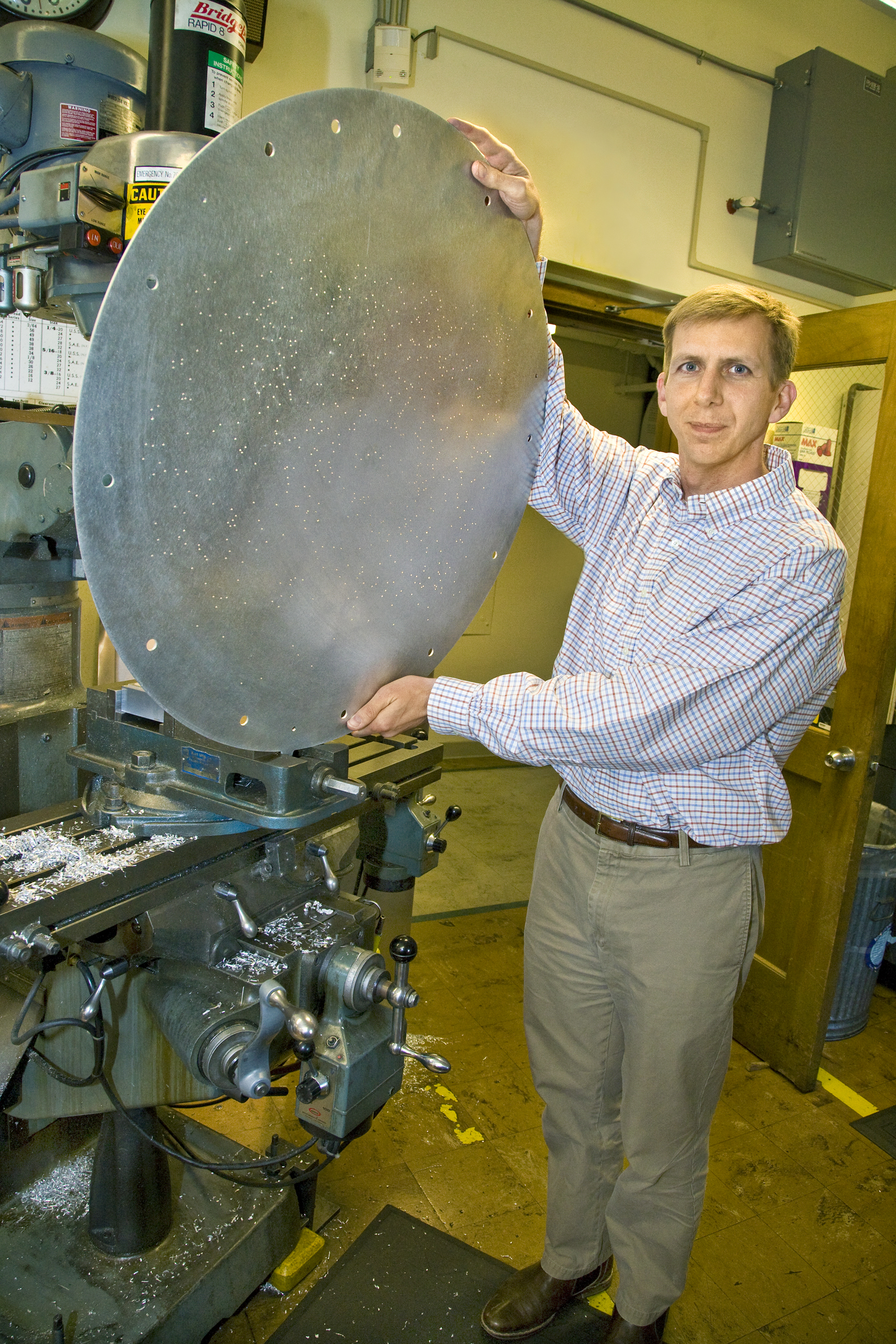 David Schelegel, PI of BOSS, shows off a plug plate. Image credit: LBL