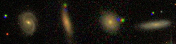 Asteroids (the three coloured dots) found near galaxies by citizen scientists at Galaxy Zoo.