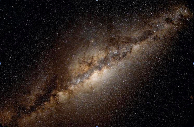Figure 1: The inner part of the Milky Way Galaxy, with numerous stars intermixed with giant clouds of interstellar gas and dust.  Image credit: Serge Brunier.