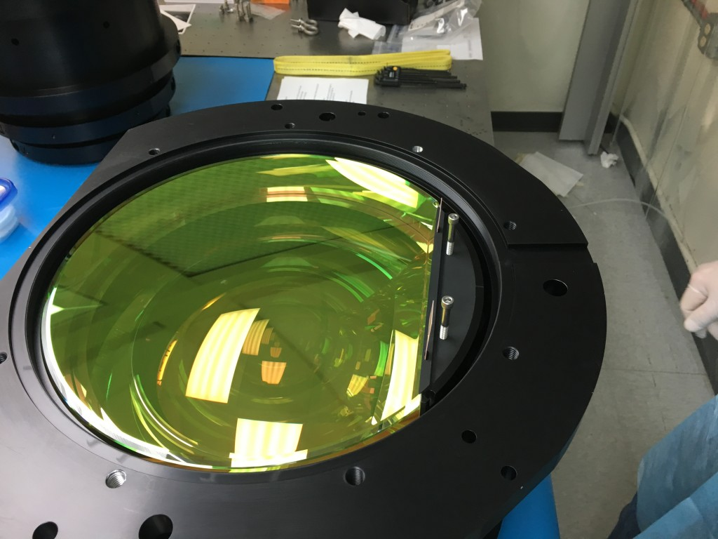 This is one of the APOGEE-2S spectrograph's lenses (there are six of them in total) up close. It is made of fused silicon, is opaque to our eyes, but is transparent to infrared light. You can see light reflecting from its surface in this photo