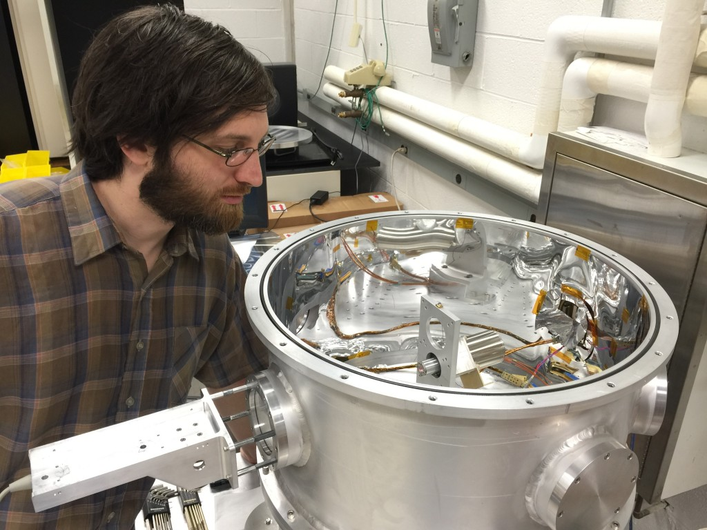 Josh Peebles from Johns Hopkins is seen here preparing the collimator positioning actuator for cryogenic testing.